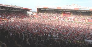 Fans on pitch-Promotion