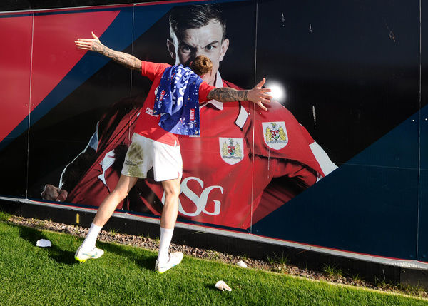 Bristol City's Aden Flint kisses a photo of himself as Bristol City are crowned champions of League One - Photo mandatory by-line: Joe Meredith/JMP - Mobile: - 18/04/2015 - SPORT - Football - Bristol - Ashton Gate - Bristol City v Coventry City