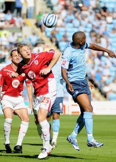 Brian Wilson heads clear from Coventry`s Clinton Morrison