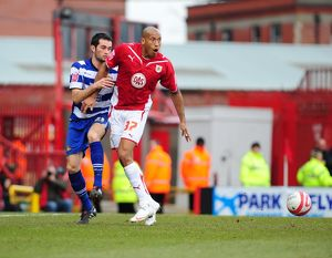 Chris Iwelumo holds off Sam Hird