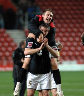David Noble and Jamie McCombe celebrate on the final whistle
