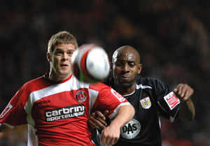 Dele Adebola chases Charlton's Martin Cranie for the ball