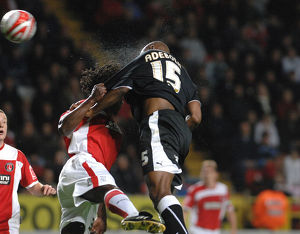 Dele Adebola tussles for the ball with Charlton's Linvoy Primus