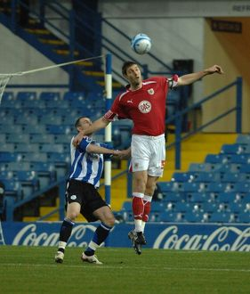 Jamie McCombe climes above the sheffield wednesday front line