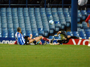 Keeper Adriano Basso saves from sheffield wednesday forward leon clarke