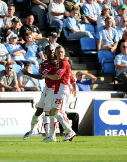 Liam Fontaine and Brian Wilson smother Nicky Maynard after his equalizer