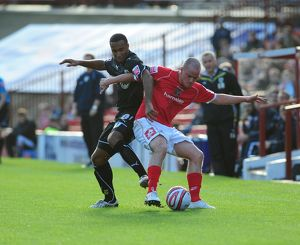 Nicky MAynard tussles with Ian Hume