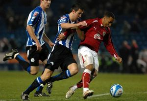 Nicky Maynard tussles with Richard Wood